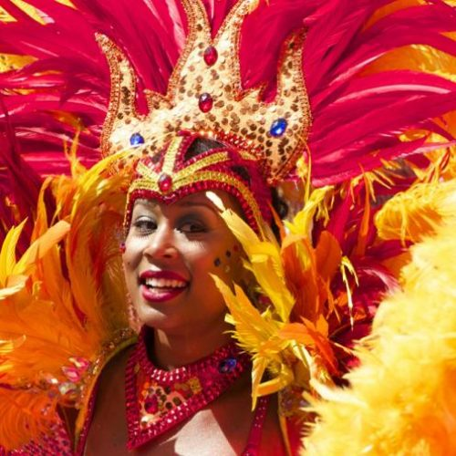 notting_hill_carnival_woman_in_costime_1300x650pixels